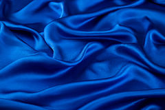 Blue luxurious silk, wavy fabric. Abstract background luxury cloth or liquid wave or wavy folds of grunge silk texture satin velvet material or luxurious Royalty Free Stock Photo