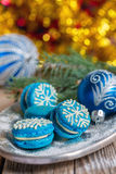 Blue macarons with Christmas decor. Stock Images