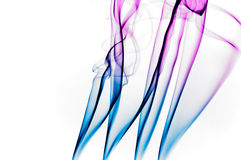 Blue and magenta smoke. Over white background Royalty Free Stock Photo