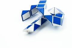 Blue magic snake and ruler shape twist puzzle Stock Photos