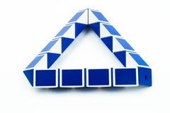 Blue magic snake and ruler shape twist puzzle Stock Photo
