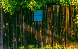 Blue mailbox on a wooden fence royalty free stock photography
