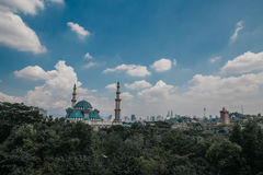 Blue Majestic Mosque. Bright sunny day with beautiful clouds and a blue majestic mosque Royalty Free Stock Images