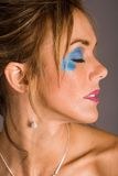 Blue makeup. Beautiful woman in blue makeup Royalty Free Stock Photo