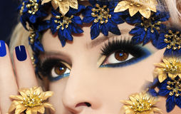 Blue makeup. Blue makeup for brown eyes with flower accessory Royalty Free Stock Photography