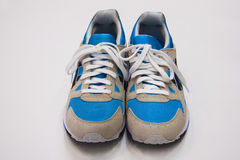 Blue  male shoes front. Sport shoes male for running over white background Royalty Free Stock Photos