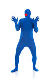 Blue: Man with Clown Nose. Series with a man dressed in a blue bodysuit or morphsuit.  Isolated on white background.  Good for situations where an anonymous Stock Image
