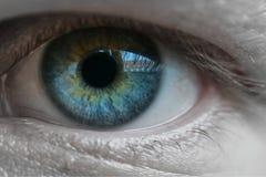 Blue man eye macro shot stock images