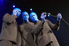 Blue man group performance. Blue men on stage during a live concert performance in Miami Stock Photos