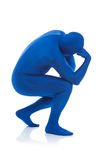 Blue: Man Mimics Thinker Statue. Series with a man dressed in a blue bodysuit or morphsuit.  Isolated on white background.  Good for situations where an Royalty Free Stock Photography