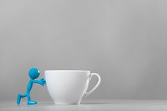 Blue man pushing and coffee cup. Stock Image