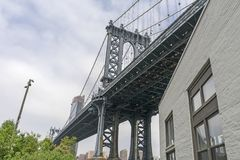 Blue Manhattan Bridge standing stock photos