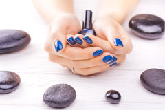 Blue manicure with black stones Royalty Free Stock Photo