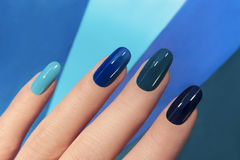 Blue manicure. Stock Photo