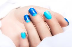 Blue manicure in light and dark colors of lacquer Royalty Free Stock Photos