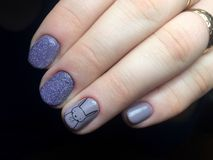 Blue manicure on the nails. Female manicure. On the hand royalty free stock photo