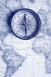 Blue map & blue compass Royalty Free Stock Photo