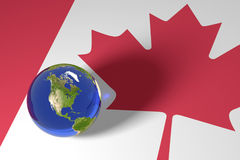 Blue Marble and Canadian Flag. Blue Marble and Canadian maple Leaf Flag Royalty Free Stock Photo
