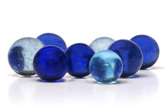 Blue Marbles. A handful of blue marbles of varying shades isolated on a white background Royalty Free Stock Images