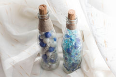 Blue marbles. And glass bottles Stock Photography