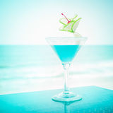 Blue margarita cocktail with lime fruit and cherry decoration Stock Photos
