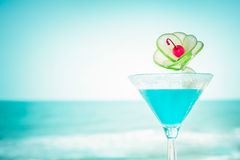 Blue margarita cocktail with lime fruit and cherry decoration Stock Images