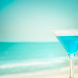 Blue margarita cocktail at tropical ocean beach Royalty Free Stock Photo