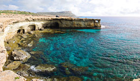 Blue marina and sea caves Stock Photo