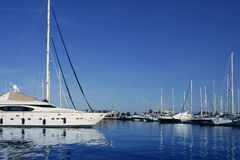 Blue marina view saltwater vacation dock. In Mediterranean sea Royalty Free Stock Photos