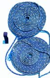 Blue maritime rope coiled up against a white background royalty free stock photography