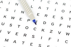 Blue Marker on solving crossword puzzle Royalty Free Stock Photos