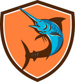 Blue Marlin Fish Jumping Shield Retro. Illustration of a blue marlin fish jumping viewed from front set inside shield crest on isolated background done retro Stock Images