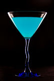 Blue Martini. On black background Royalty Free Stock Photography