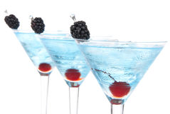 Blue martini cocktails row alcohol Royalty Free Stock Photos