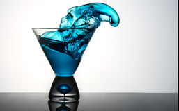 Blue Martini Glass Splashing Royalty Free Stock Photography