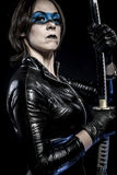 Blue mask, Woman with katana sword in latex costume Royalty Free Stock Images