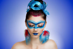 Blue mask woman. Young beautiful woman lady model woman character butterfly bird firebird ice queen. Creative perfect fantasy makeup. Bright saturated colors red royalty free stock photo