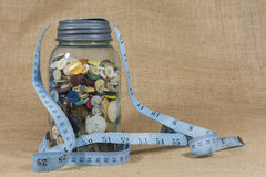 Blue Mason jar full of buttons Royalty Free Stock Photography