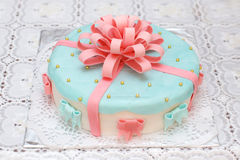 Blue mastic cake decorated with pink ribbons, closeup Royalty Free Stock Image