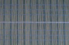Blue mat. Blue hand-crafted straw mat texture Royalty Free Stock Image