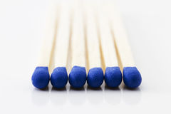 Blue match heads. Makro of some blue match heads on white background Stock Image
