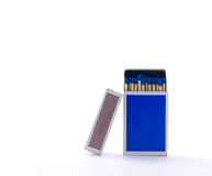 Blue matchbox with safety matches isolated on white background Royalty Free Stock Image