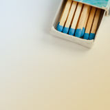 Blue matches in vintage matchbox. Wooden multicolored, blue matches in vintage matchbox. Retro colors background. copy space. Macro view, toned photo stock images