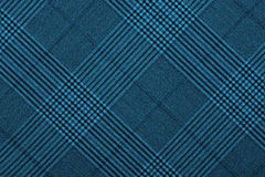 Blue material in geometric patterns, a background. Or texture Stock Photos