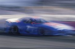 A blue Mazda in the Toyota Grand Prix Race at the Indy Car World Series in Long Beach, CA Royalty Free Stock Photo