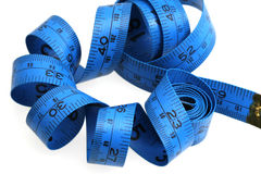 Blue measure tape. On white background Royalty Free Stock Image