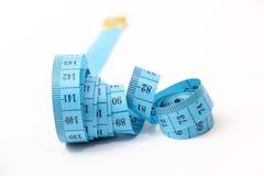 Blue measuring tape Royalty Free Stock Photo