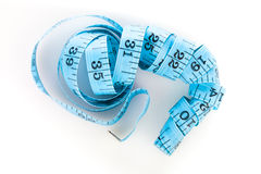 Blue measuring tape, shot from above, on white Royalty Free Stock Images