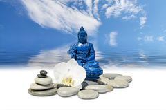 Blue Medicine Buddha Bhaisajyaguru,zen stone,white orchid flowers and sky reflected in water. Zen or Feng-Shui background-Blue Medicine Buddha Bhaisajyaguru,zen Royalty Free Stock Images