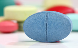 Blue medicine pill Royalty Free Stock Image